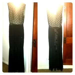 Long dress black lace over tan with belt.